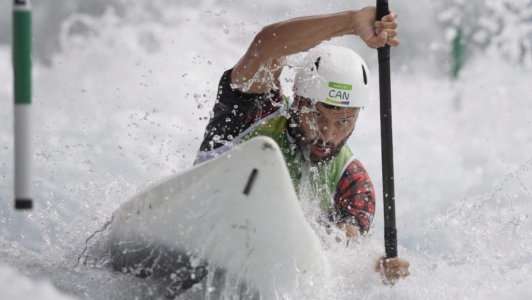 Michael Tayler racing his kayak in slalom course