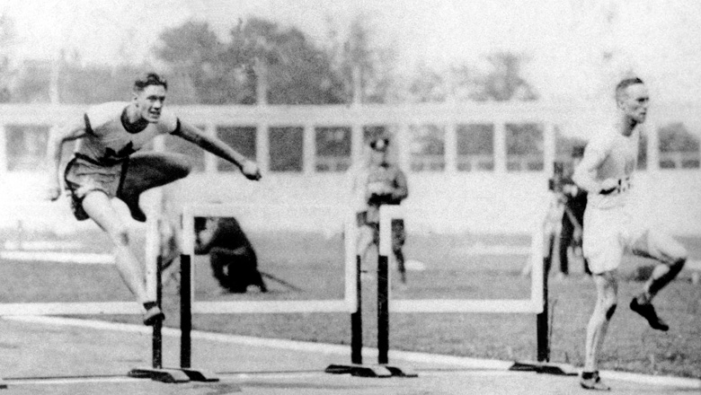 Earl Thompson competing in hurdles
