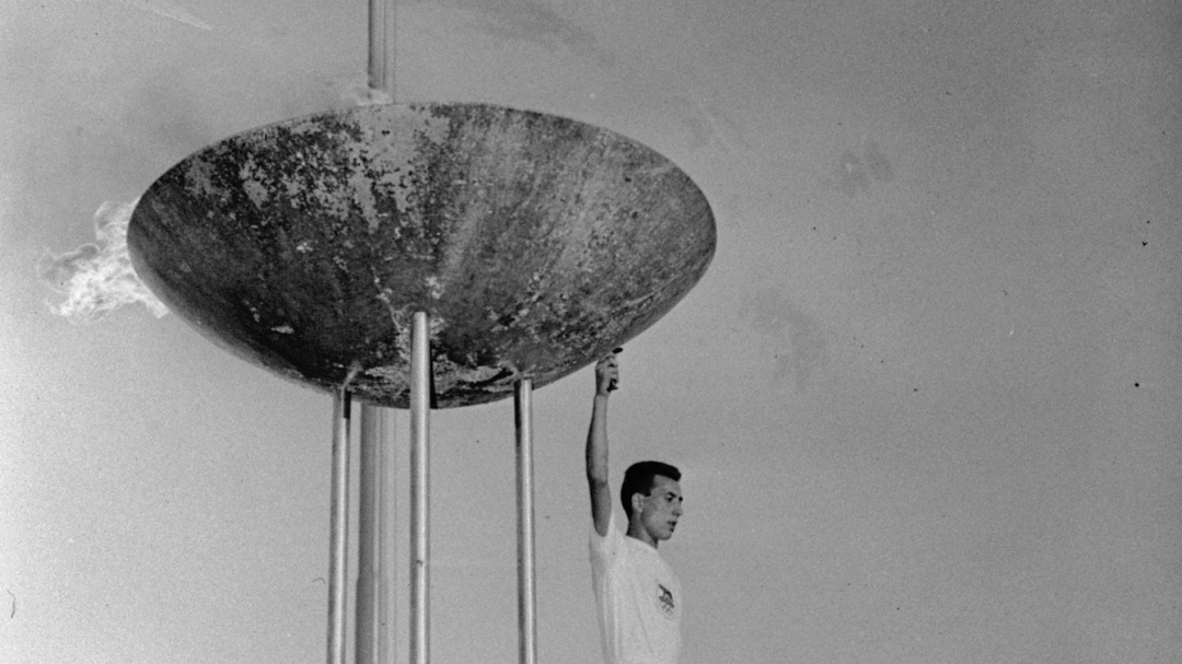 athlete in front of the Rome 1960 torch