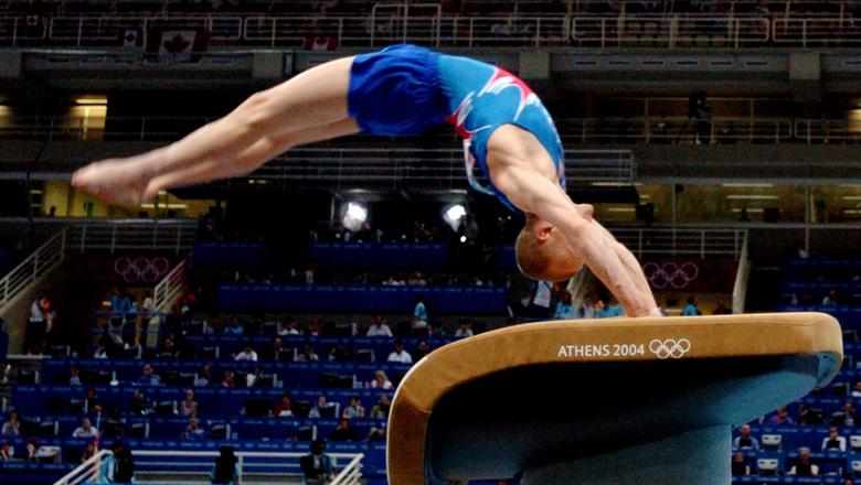 gymnast Kyle Shewfelt competing