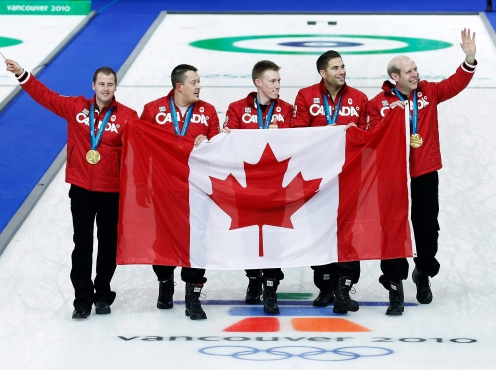 Canada alternate Adam Enright, left to right, lead Ben Hebert second Marc Kennedy, third John Morris and skip Kevin Martin show off their gold medals after defeating Norway during Olympic men's curling finals action at the Olympic Centre on Saturday, Feb. 27, 2010 during the Olympic Winter Games in Vancouver. THE CANADIAN PRESS/Nathan Denette