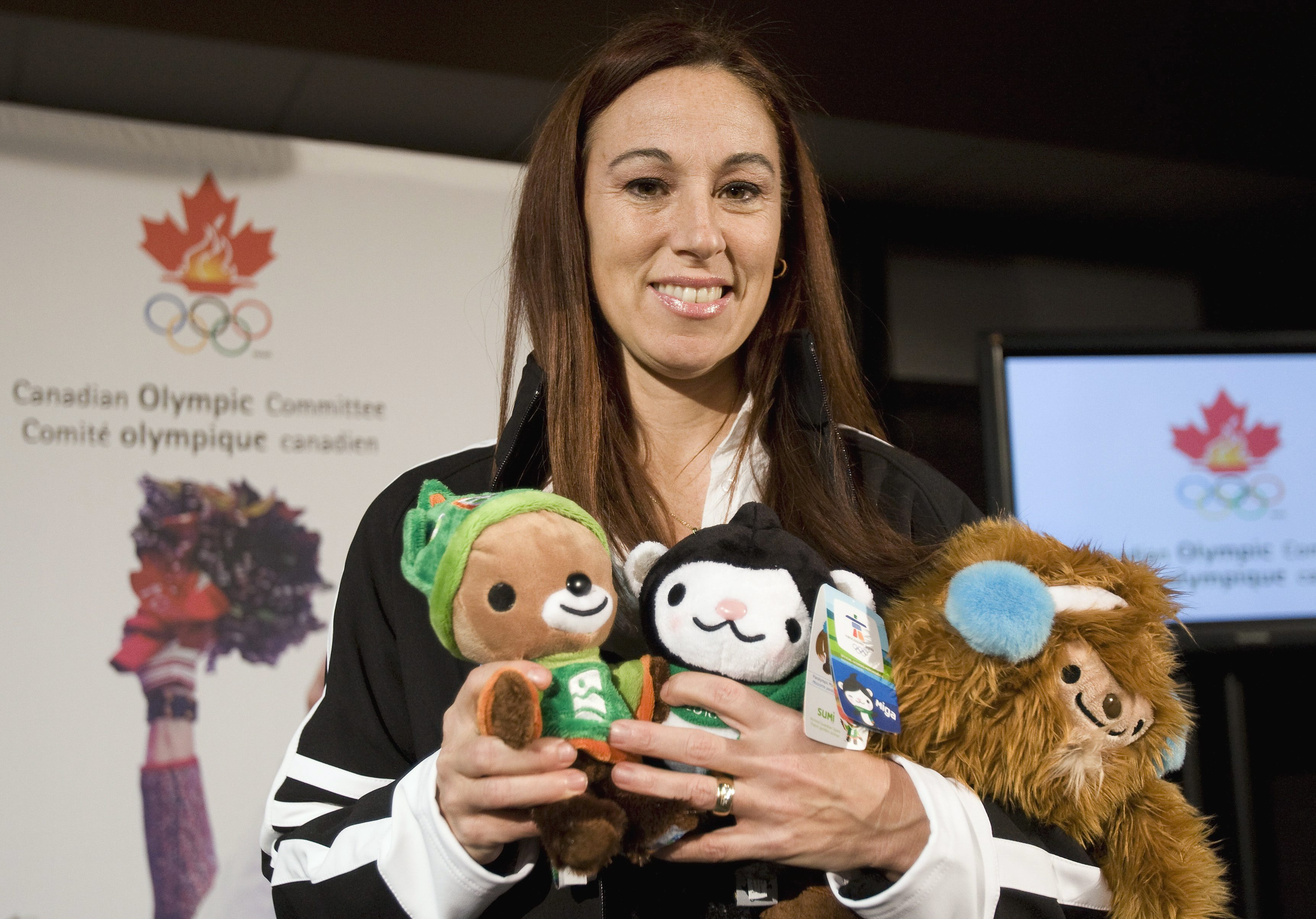 Nathalie Lambert holds the Vancouver 2010 mascots