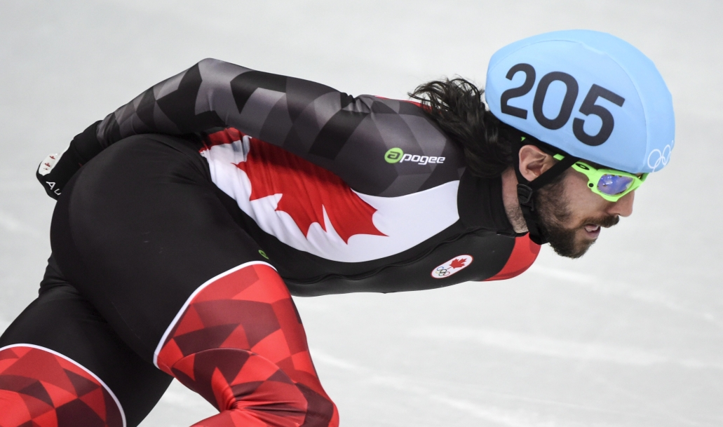 Charles Hamelin rounds a corner in the men's 1000 metre speedskating