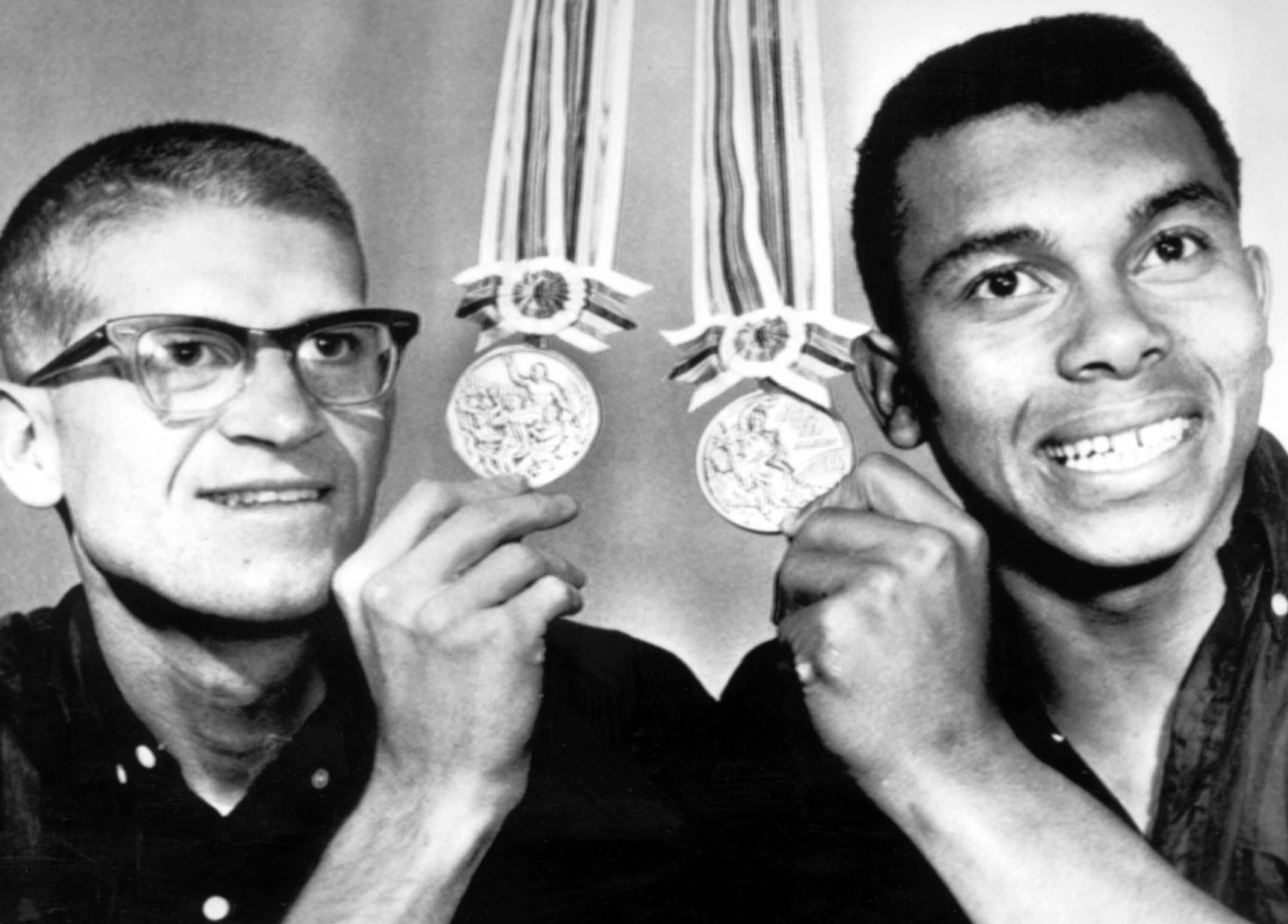 Bill Crothers and Harry Jerome with their silver and bronze medals from the Tokyo 1964 Olympic Games.