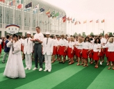 Canadian athletes gather to watch a flag raising
