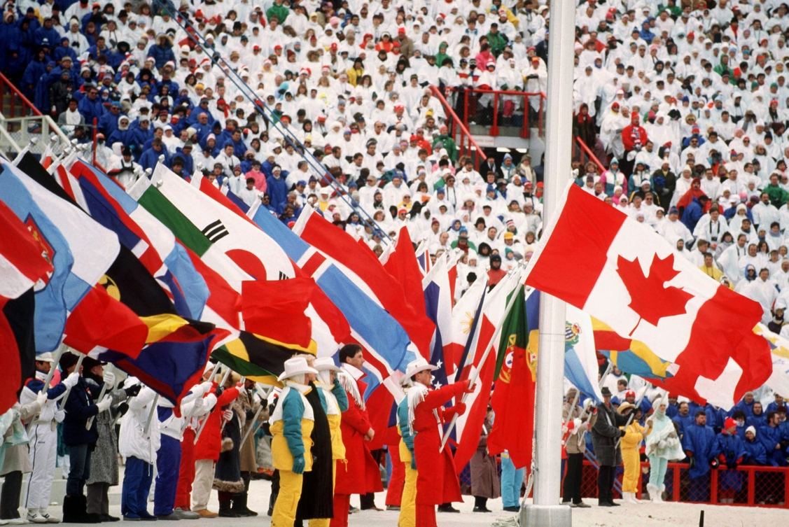 Brian Orser carrying the Canadian flag