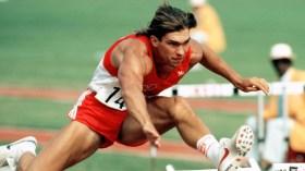 Dave Steen mid-hurdle