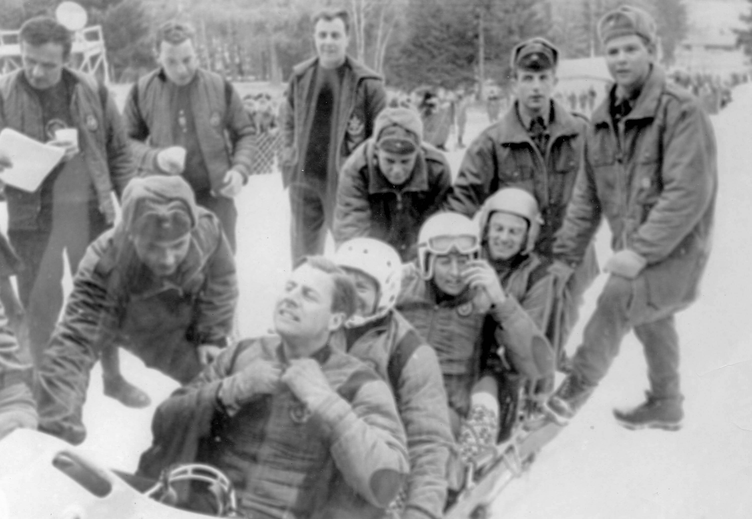 Black and white photo of bobsleigh crew
