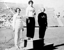 Three women stand on the podium