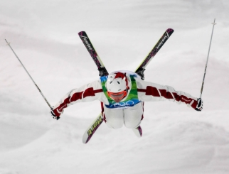 Alex Bilodeau of Rosemere, Que. looks for his jump landing during men's moguls training for the Olympic Winter Games at Cypress Mountain in Vancouver, B.C. (CP PHOTO)(HO-COC-Mike Ridewood)