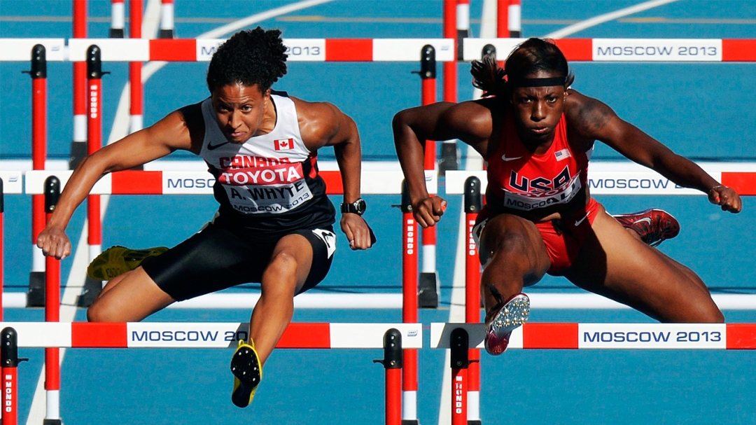Angela Whyte jumping over a hurdle
