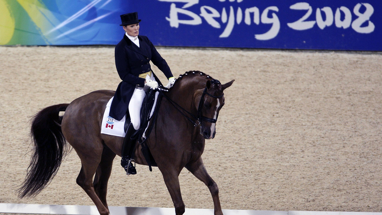 Canada's Ashley Holzer riding her horse Pop Art competes at the Equestrian Grand Prix Special Dressage Individual competition of the Beijing 2008 Olympics Equestrian in Hong Kong, Saturday, Aug. 16, 2008. (AP Photo/Kin Cheung)