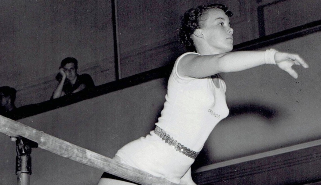Ernestine Russell competing in gymnastics