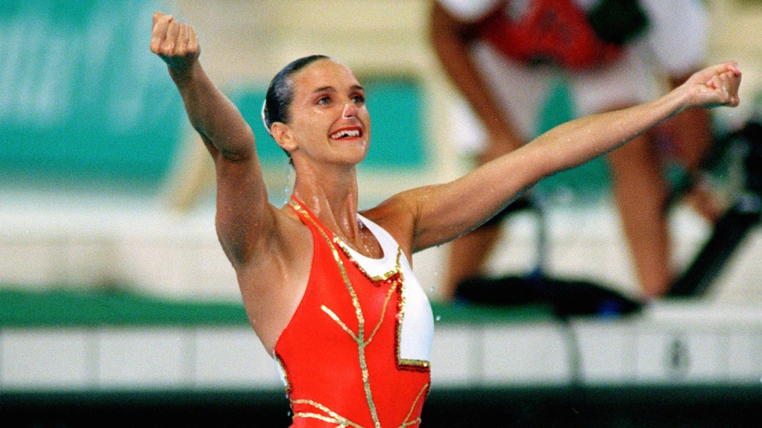 Sylvie Fréchette celebrates with her arms in the air