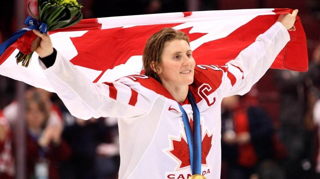 Wickenheiser celebrating with Canadian flag