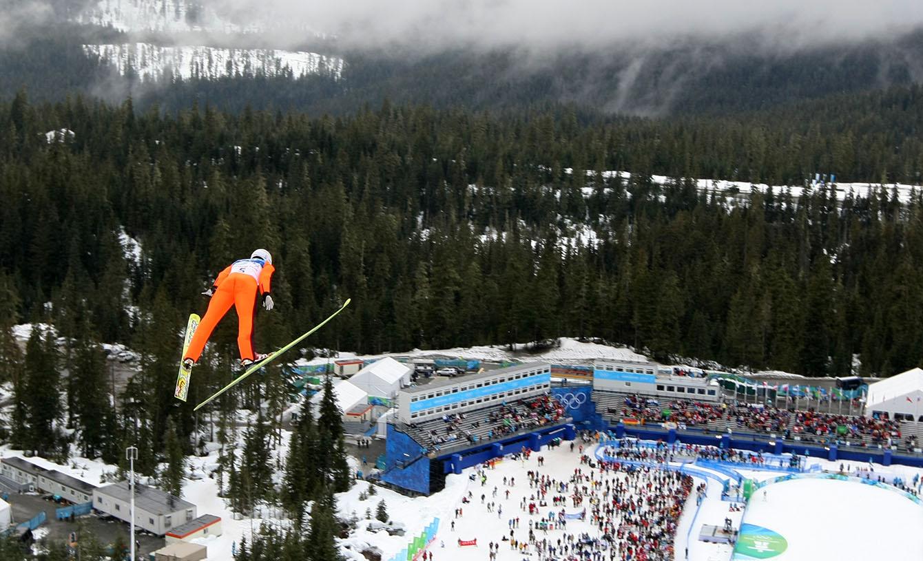 Wide shot of Jason Myslicki ski jumping