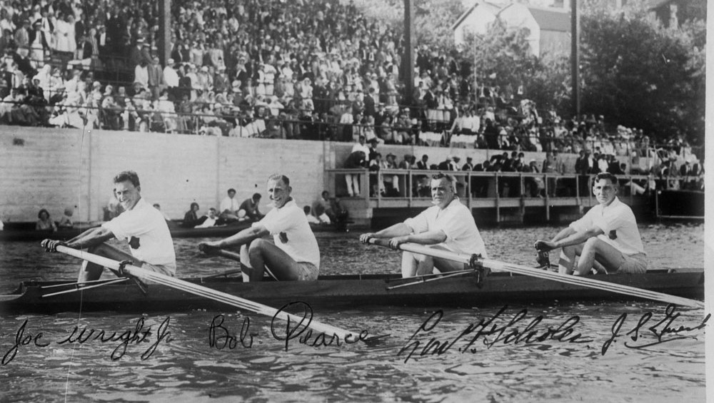 Joseph Wright, left, rowing with his team