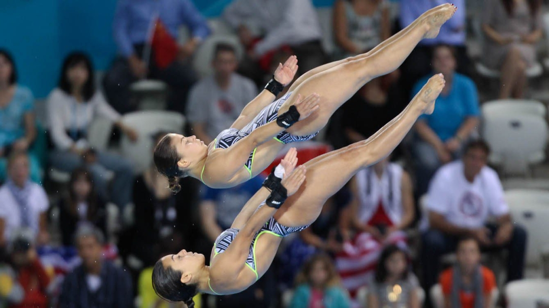 Roseline Filion and Meaghan Benfeito in midst of a dive
