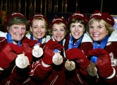 Canadian Women's Curling team (left to right) Cheryl Noble, of Victoria, Kelley Law, of Coquitlam, B.C., Diane Nelson, of Burnaby, B.C., Julie Skinner, of Victoria, and Georgina Wheatcroft, of Victoria, show off their bronze medals Thursday Feb. 21, 2002, at the 2002 Olympic Winter Games in Salt Lake City. They beat Team USA to bring home the bronze. (CP Photo/COC/Andre Forget)