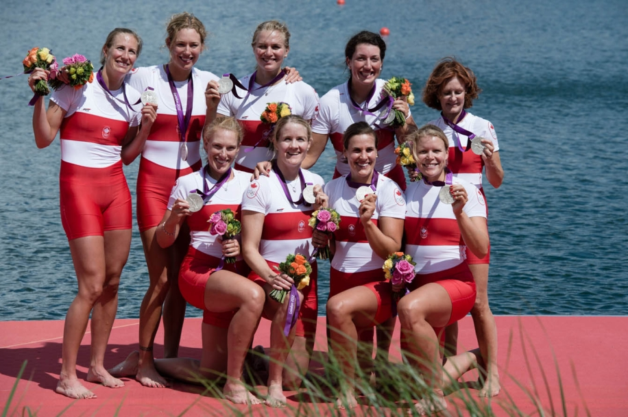 The women's eights team poses with their medals