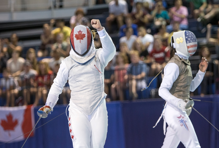 Kelleigh Ryan celebrates winning a point against Lee Kiefer of the United States during the Team Women's Foil gold medal match at the Pan-American Games in Toronto