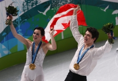 Tessa Virtue of London, Ont. and Scott Moir of Ilderton, Ont. do a victory lap with their gold medals in ice dance at the Pacific Coliseum at the Olympic Winter Games in Vancouver, B.C, Monday, Feb. 22, 2010. (CP PHOTO)2010(HO-COC-Mike Ridewood)