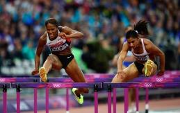 Phylicia George jumping hurdle