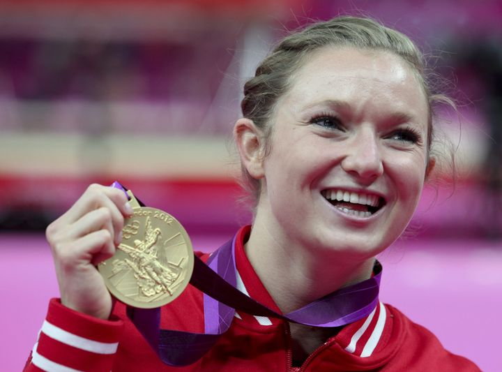 athlete posing with her medal at London 2012