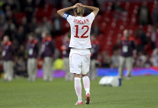 Christine Sinclair with hands on her head