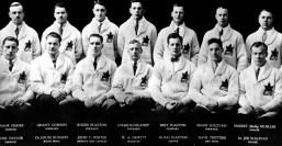 "The University of Toronto Graduates, representing Canada, participate at the St. Moritz 1928 Olympic Winter Games. From left (top), Frank Fisher, Grant Gordon, Roger Plaxton, Charlie Delahey, Bert Plaxton, Frank Sullivan,Norbert ""Stuffy"" Mueller, (bottom) Ross Taylor, Dr. Louis Hudson, John C. Porter, COCch Mgr. W.A. Hewitt, Hugh Plaxton, Dave Trottier and Dr. Joe Sullivan. (CP Photo/COC)"