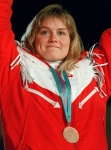 Canada's Karen Percy celebrates her bronze medal win in the alpine ski event at the 1988 Olympic Winter Games in Calgary. (CP PHOTO/ COC/S. Grant)