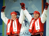 Canada's Pierre Lueders (left) and Dave MacEachern celebrate their gold medal win in the two-man bobsleigh event at the 1998 Nagano Winter Olympics. (CP PHOTO/COC/F. Scott Grant)