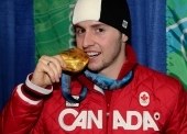 Alex Bilodeau of Rosemere, Que. with his gold medal for men's moguls at the Olympic Winter Games in Vancouver, B.C, Monday, Feb. 15, 2010. (CP PHOTO)(HO-COC-Mike Ridewood)