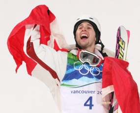 Alexandre Bilodeau celebrates his gold medal win at the men's mogul at Cypress Mountain in Vancouver, B.C., Sunday February 14, 2010, at the 2010 Vancouver Olympic Winter Games. THE CANADIAN PRESS/Sean Kilpatrick