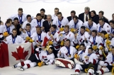 Team Canada captain Mario Lemieux and goalie Martin Brodeur are surrounded by teammates as they pose for a team photo after they won over Team USA to win the gold medal in hockey Sunday Feb. 24, 2002 at the 2002 Olympic Winter Games in Salt Lake City.
