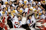Canadian women's hockey team coach Daniele Sauvageau (centre) and the Canadian women's hockey team pose for a team picture with their gold medal after defeating the United States 3 - 2 in Salt Lake City , Utah during the Winter Olympics, Thursday, Feb. 21, 2002. (CP PHOTO/COC/Mike Ridewood)