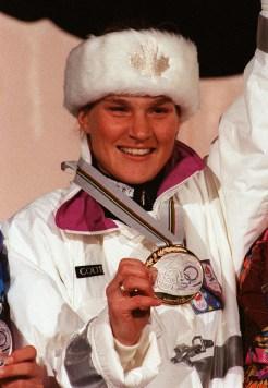 Kerrin Lee Gartner holds her gold medal on the podium
