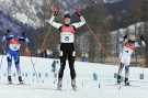 Chandra Crawford (8) of Canmore, Alberta raises her arms to celebrate as she crosses the finish line to win the gold medal women's sprint cross country skiing race at the Olympic Games in Pragelato Plan, Italy on Tuesday, February 22, 2006. Silver medalist Claudia Kuenzel (4) of Germany and bronze medalist Alena Sidko (5) of Russia follow close behind.(CP PHOTO/Frank Gunn)