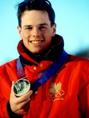 Canada's Jean-Luc Brassard celebrates after winning the gold medal in the men's freestyle skiing moguls event at the Lillehammer 1994 Olympic Winter Games. (CP PHOTO/ COC/ Claus Andersen)