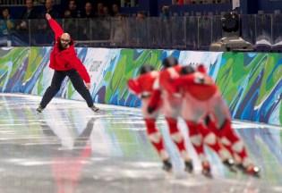 Coach Marcel Lacroix signals the men's team pursuit