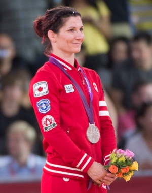 Canada's Tonya Verbeek wears her silver medal for wrestling in the 55kg freestyle category at the 2012 London Olympics, August 9, 2012. Verbeek lost to Saori Yoshida of Japan. THE CANADIAN PRESS/HO, COC - Jason Ransom