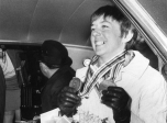Nancy Greene wears her medals in the back of a car