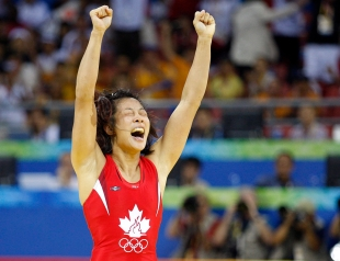 Canada's Carol Huynh from Hazelton, B.C. celebatres her gold medal victory over Chiharu Icho from Japan in the women's freestyle 48kg wrestling final at the Beijing 2008 Summer Olympics in Beijing, Saturday, August 16, 2008.