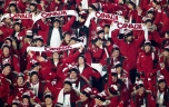 Canadian team members hold up Canada scarves during the athlete's parade at the opening ceremonies for the Vancouver 2010 Olympic Winter Games in Vancouver, Friday, Feb. 12, 2010. THE CANADIAN PRESS/Jonathan Hayward
