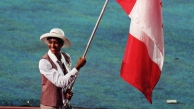 Charmaine Crooks bears the Canadian flag at the Atlanta 1996 Olympic Games Opening Ceremony. (CP Photo/COC)