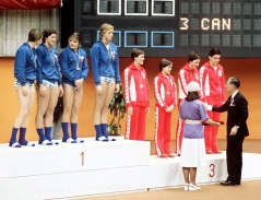 Canadian swimming relay team stands on podium