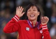 Carol Huynh celebrates her London 2012 bronze medal during presentation.