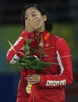 Crying listening to national anthem on podium