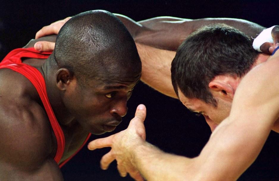 Daniel Igali, of Surry, B.C., wrestles Emzar Bedineishvili