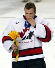 Team Canada goalie Martin Brodeur kisses his gold medal after they won over Team USA to win the gold medal in hockey Sunday Feb. 24, 2002 at the 2002 Olympic Winter Games in Salt Lake City. Team Canada won 5-2 over Team USA. (CP Photo/COC/Andre Forget)